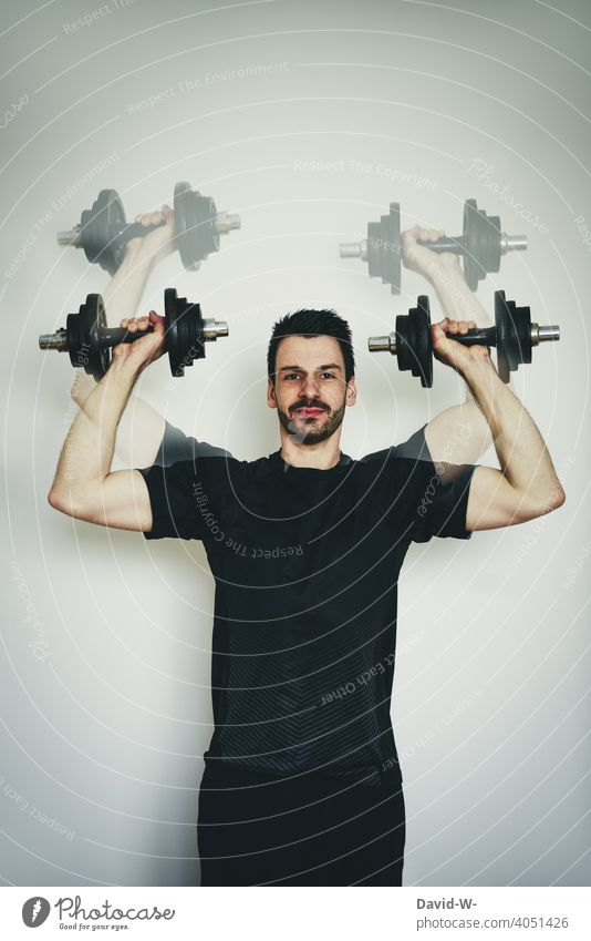 do sports at home with dumbbell Sports Quarantine Sportsperson exercise muscle Man Fitness Dumbbells Effort pandemic fit Healthy workout
