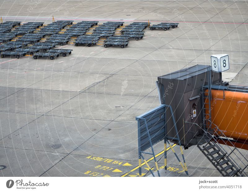 Container dollies at gate 8 boarding bridge Airport Ground markings Authentic Line Concrete slab number range Gate TXL Gangway Airfield bay Airport Berlin-Tegel