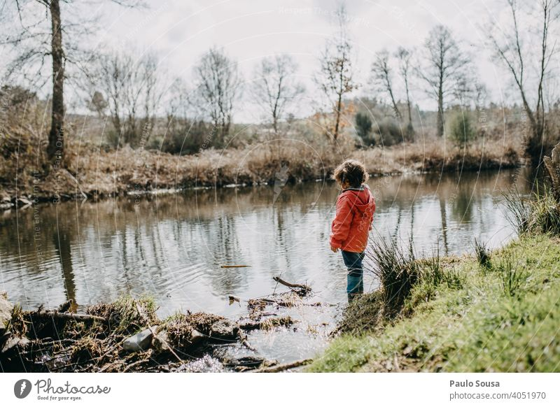 Cute girl  at riverside Child childhood 1 - 3 years Girl Colour photo Caucasian River Nature Authentic Happy Joy Exterior shot Playing Happiness Human being