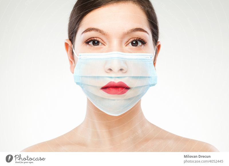 Beautiful caucasian young woman headshot wearing transparent medical face mask covid-19 coronavirus portrait fashion art concept edit adult attractive