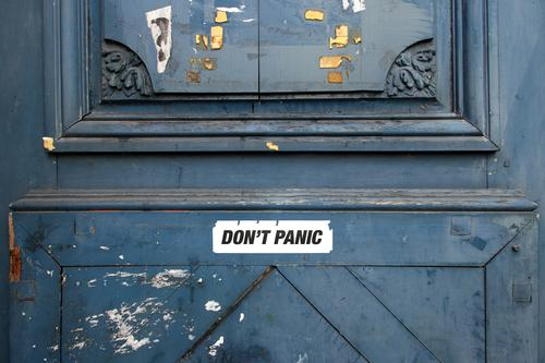don't panic sticker on wooden door no panic None Panic stickers Wooden door Plastered Patina street art urban tranquillity Calm relaxed keep calm Serene Remark