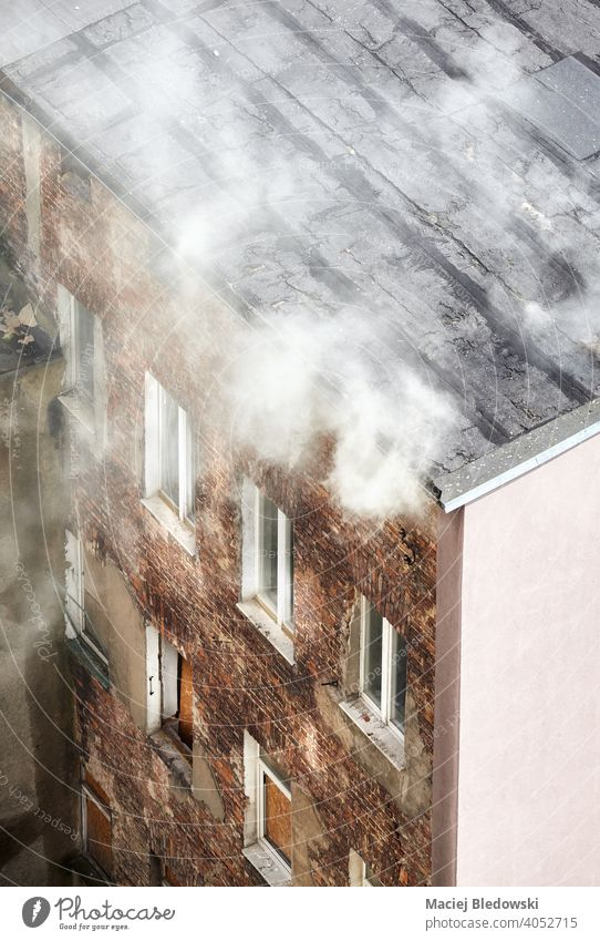 Fire of an old townhouse building, view from above. fire smoke city aerial danger fear insurance accident poisonous residential risk burn roof destruction