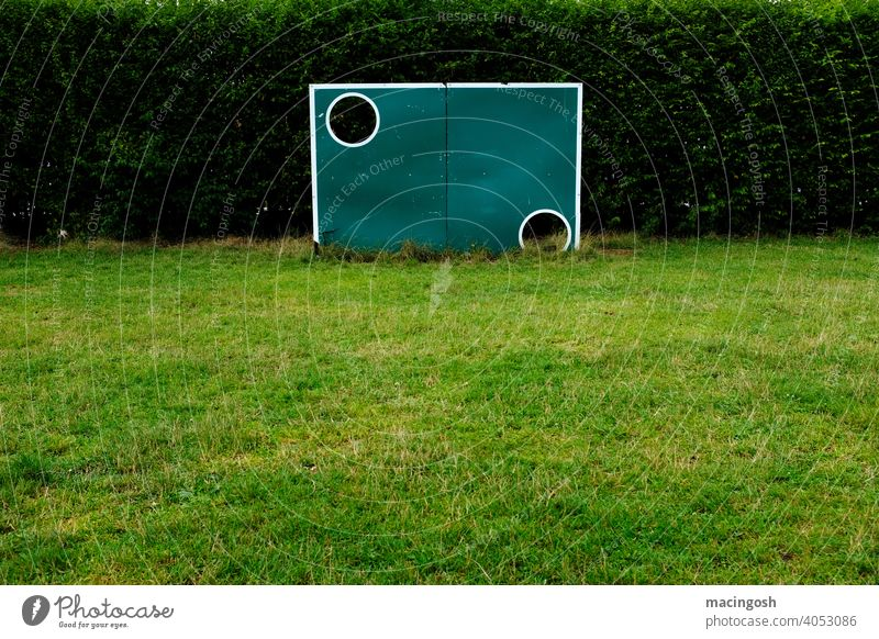 Old goal wall on an empty sports field Foot ball Football pitch Sporting grounds lockdown Sports Sports Training Soccer Training Soccer training Green Deserted