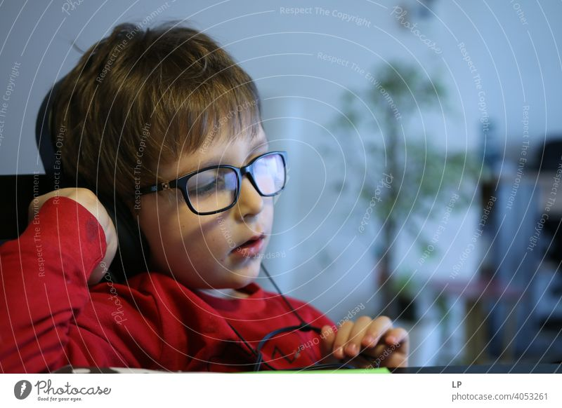 child wearing glasses and listening to headphones safety epidemic quarantine music family time Listening Listen to music Technology Questioning Relaxation