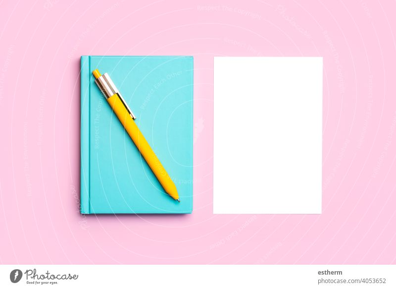 workspace desk with blue notepad,yellow pen and white paper with copy space background notepaper pencil mock frame memory desktop mockup idea color project