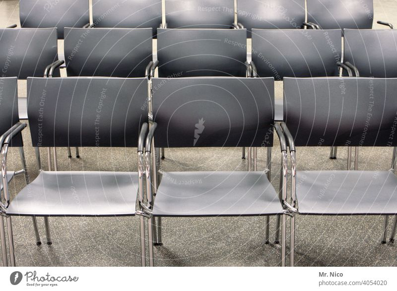 empty rows of chairs Chair Sit Row of chairs Seating Row of seats Empty Free Seating capacity Places Event Audience Structures and shapes Concert Hall Gray