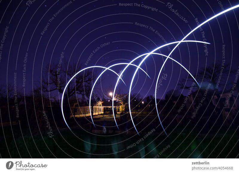 Flashing in the garden at night Evening Branch Tree Movement blink variegated Dynamics fantasy flicker Garden Sky allotment Garden allotments Art Light