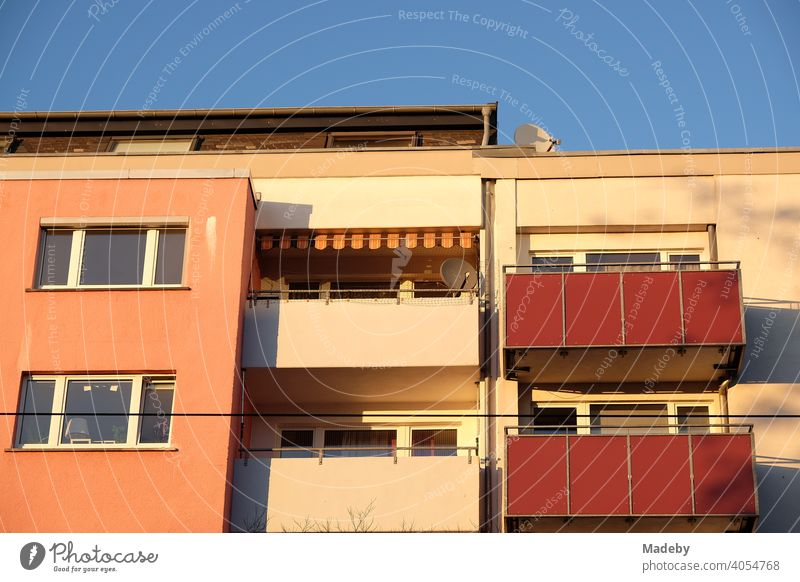 Modern apartment house in pastel colours with balconies in the light of the evening sun in summer in the Hanauer Landstraße in the Ostend of Frankfurt am Main in Hesse
