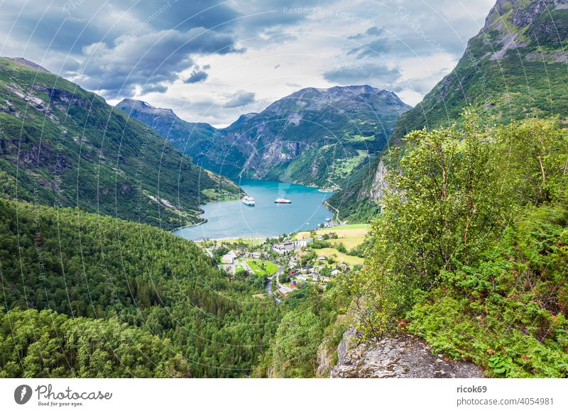View of Geiranger and the Geirangerfjord in Norway. Fjord location Harbour boat ship Building Architecture Cruise liner mountain Rock Tree Møre og Romsdal