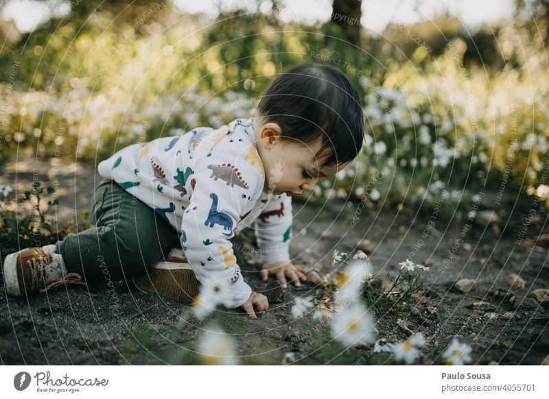 Child playing outdoors childhood Playing Nature Authentic Spring Spring fever Human being Happy Lifestyle Caucasian Happiness Joy Day Colour photo Exterior shot