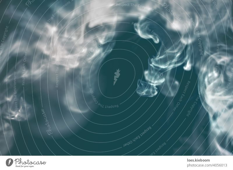 Abstract flowing steam of air humidifier with dreamy concept of underwater scene with jellyfish smoke ocean sea abstract swirl silky zen turquoise scent aroma