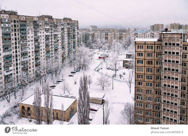 High residential buildings covered by snow in winter Europe Kiev Minska Obolon Ukraine aerial apartment architecture balcony center city city landscape