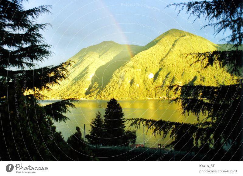 rain atmosphere Rainbow Lake Tree Light Vacation & Travel Mountain Bright Sun Sky