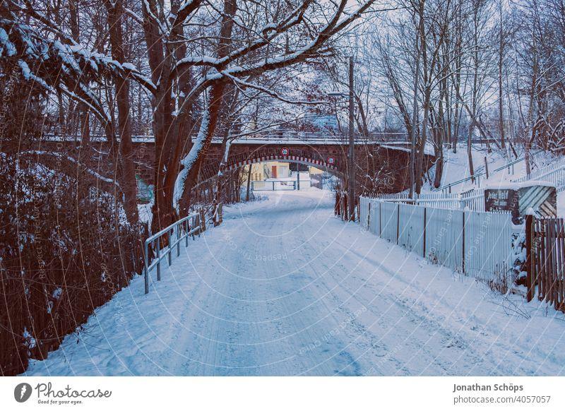 Road in winter when snow in front of railway embankment tunnel underpass Bridge Black ice Snow Street Tunnel Underpass Winter Cold Exterior shot