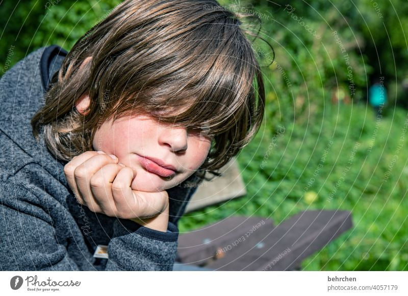total immobility listless tired Meditative Bad mood portrait Boy (child) Child Sunlight Infancy Colour photo Exasperated Hair and hairstyles Face Family