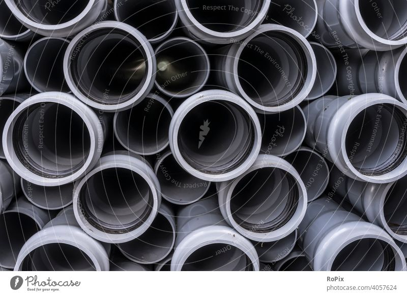 Stack of plastic water pipes. Water Straws tube Hose interdiction variegated Rubber reinforced technique microplasty Factory company environmental impact Dye