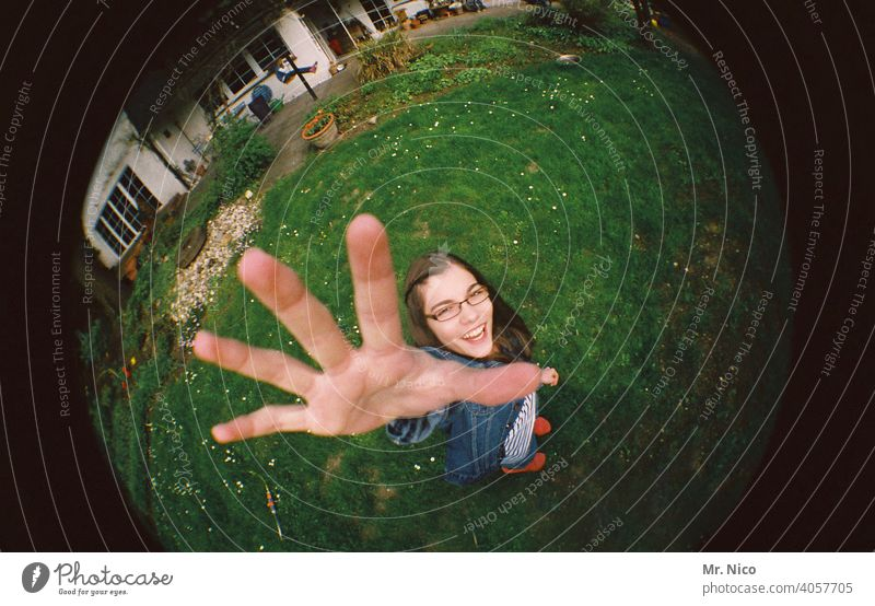 Teen stretches her hand up Feminine Garden Fingers Hand Girl Meadow House (Residential Structure) Eyeglasses Long-haired Stand Laughter Smiling Friendliness