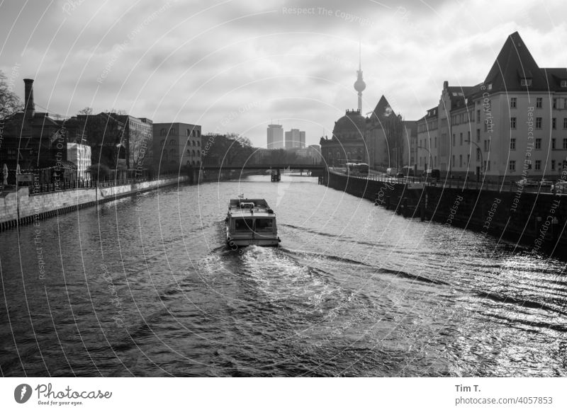 a passenger ship on the river Spree in the early morning in Berlin Television tower b/w in the morning Town Middle Capital city Downtown Exterior shot