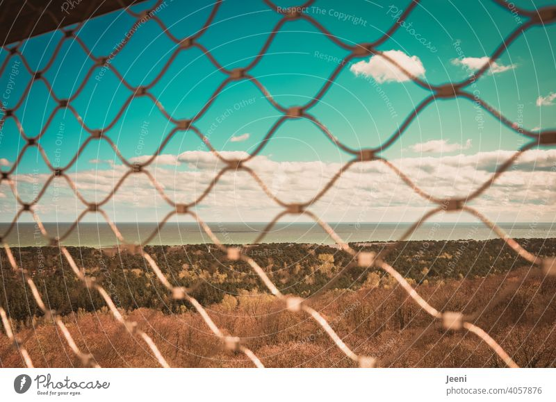Freedom so near and yet so far Water Ocean Fence penned Enclosed Grating Wire netting fence Sky Blue Blue sky Clouds White wide Captured Exterior shot Deserted