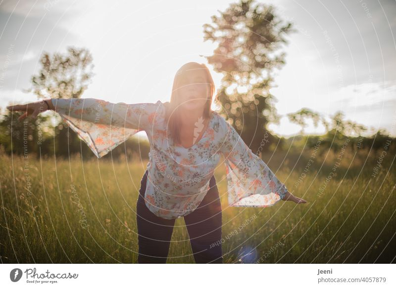 Happy woman spreads her arms like she is flying and gives an air kiss Happiness cheerful 30 - 45 years Pout Arm Flying 1 youthful Woman feminine Smiling