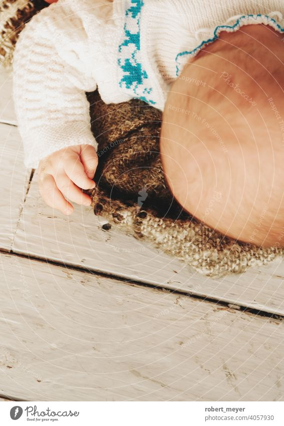 baby sleeping on a blanket Relaxation Cuteness Floor covering wood newborn boy little infant child cute childhood kid adorable beautiful human young small lying