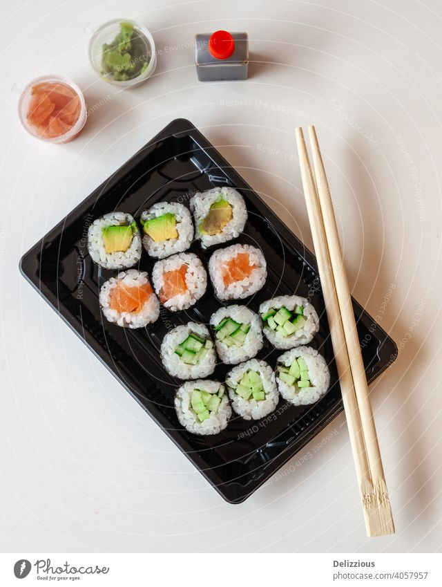 Top down view of fresh take away sushi on a white background with copy space sushis chop sticks food ginger wasabi japanese japanese food pickled ginger