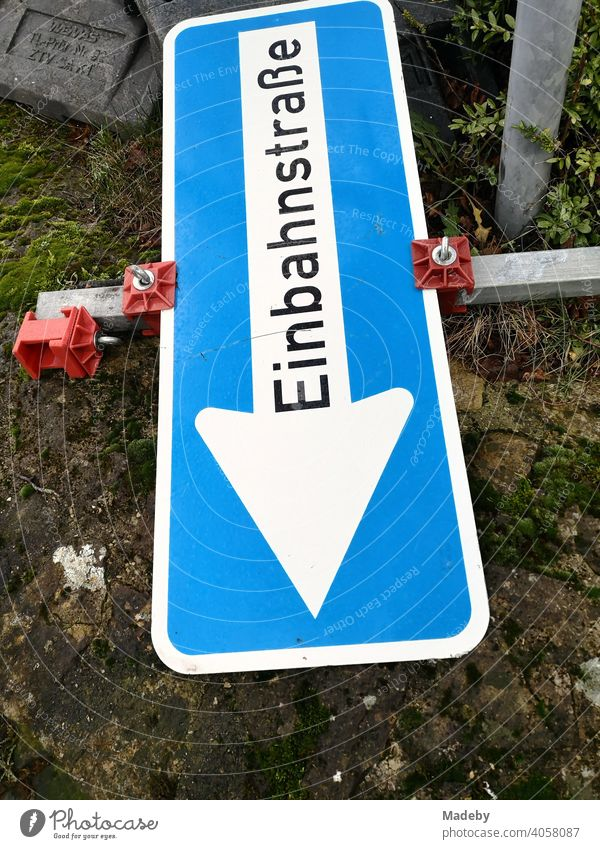 Overturned temporary traffic sign at a one-way street at a construction site in Oerlinghausen near Bielefeld at the Hermannsweg in the Teutoburg Forest in East Westphalia-Lippe