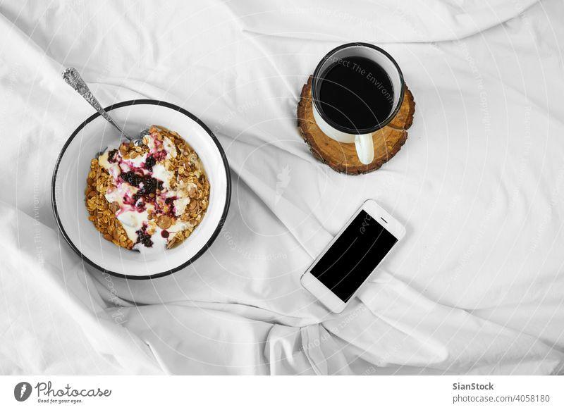 Breakfast in bed top view breakfast coffee cup white tray hot food background drink sugar sweet warm tea cream mood home closeup cozy muesli oats yoghurt phone