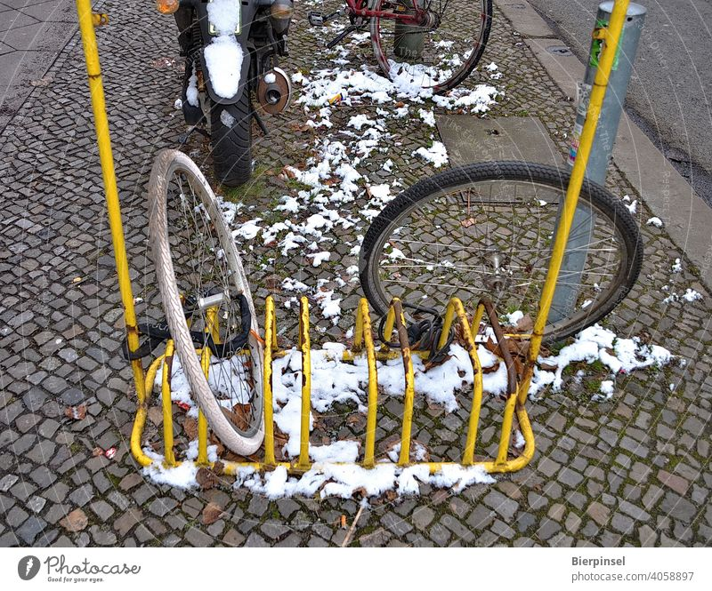 Two connected front wheels of bicycles, the rest of the bicycles have been obviously stolen Front wheel Associated Bicycle rack Theft Criminality bicycle lock