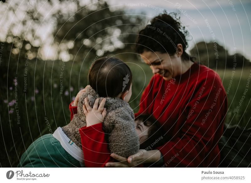 Mother with two childrens outdoors motherhood Mother's Day Mother with child Family & Relations family Caucasian 1 - 3 years 25-29 Years 30 - 45 years Infancy