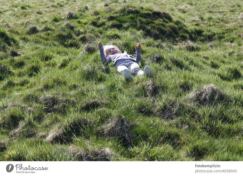 Child lying on a green grassy meadow Meadow Grass Infancy Growth Joie de vivre (Vitality) Relaxation Experiencing nature Contentment Well-being Healthy