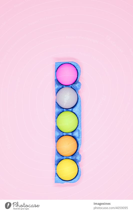 Easter eggs concept Blue Eggs cardboard Carton pastel Pink background variegated minimal Minimalistic Vertical top view Art Cardboard celebration Close-up
