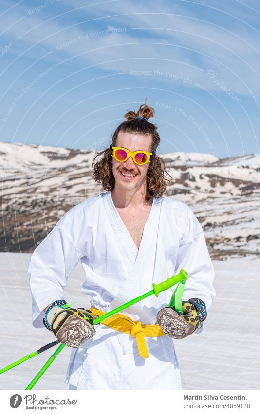 Skier dressed as a karateka at a ski station Sports action active activity adventure artistic beautiful cold cool costume downhill extreme extreme skier fast