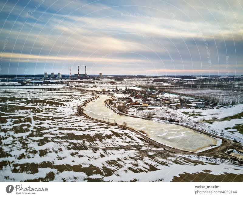 Snow melting, Season change. Gas power plant near big city Minsk, Belarus. industry factory environment pollution aerial smoke electricity energy industrial