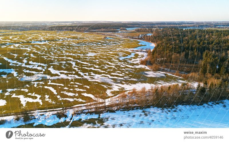 Season change. March rural landscape. Winter crops and plowed field panorama. snow spring nature aerial season background tree white forest green winter road