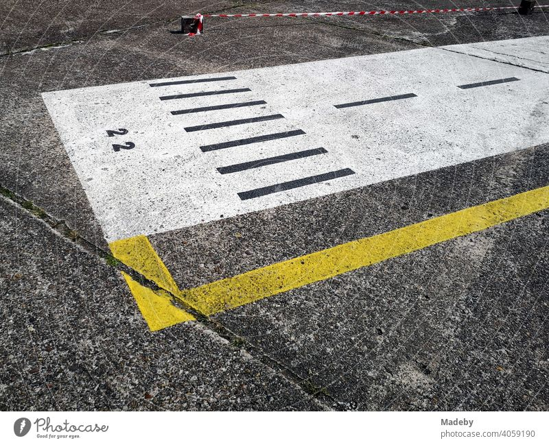 Painted runway on grey concrete at the airfield festival at the gliding airfield in Oerlinghausen near Bielefeld in the Teutoburg Forest in East Westphalia-Lippe