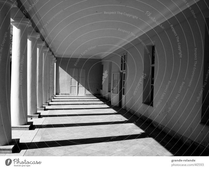 the aisle Light Diagonal Vanishing point Marianske Lazne Architecture Column Shadow Black & white photo Corridor