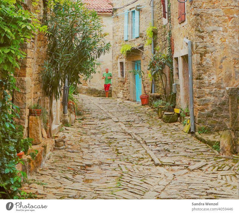 Alley in Groznjan Mountain village old village Cobblestones old walls historic village Old Architecture Street off old alley Quaint Croatia Mediterranean Flair