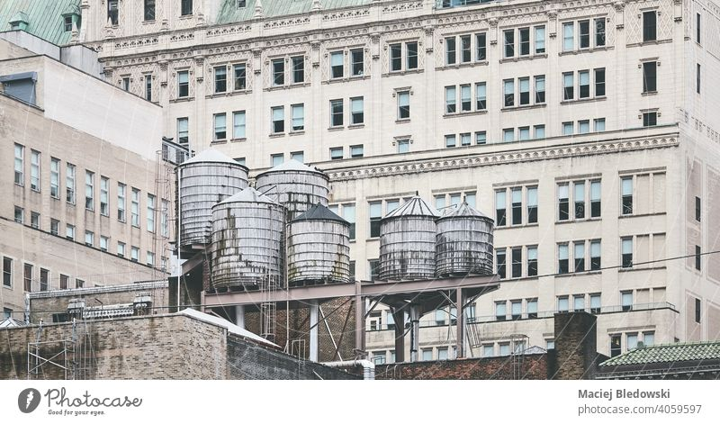 Old water towers, one of New York City symbols, USA. city building water tank architecture NYC Manhattan old cityscape picture view facade window urban