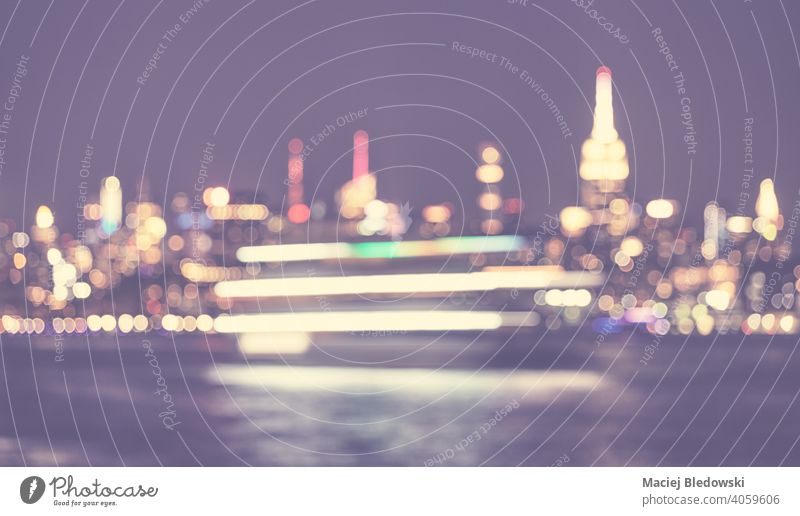 Defocused picture of New York City waterfront skyline at night, color toned urban abstract background, USA. city blurred bokeh defocused Manhattan light NYC