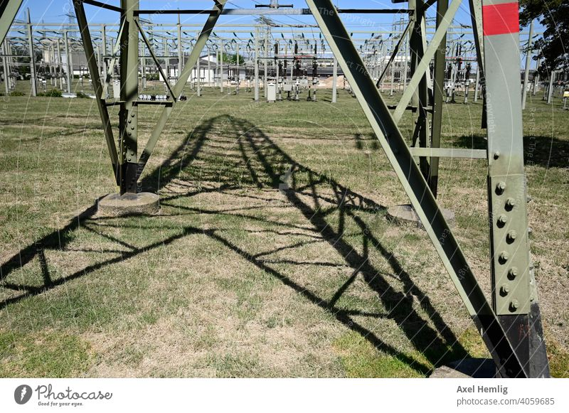 View under a high voltage pylon at its shadow Energy Energy industry energy consumption renewable Renewable energy Cable High voltage power line Electricity