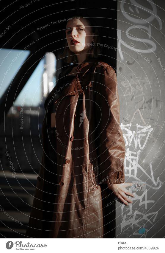 Lara Woman Looking Blonde hair Meditative Hand Coat leather coat Metal Bridge Bridge pier graffiti sunny Shadow urban Hide Mysterious