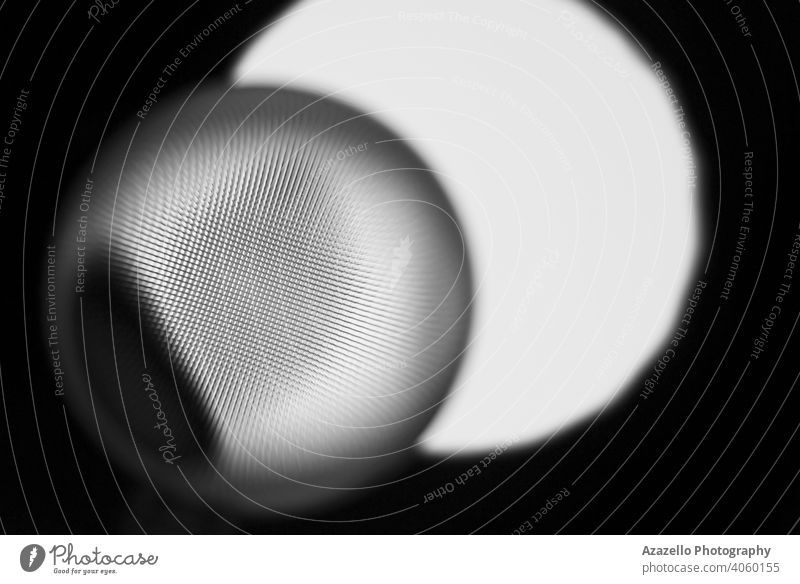 Abstract eye-shaped object in black and white. 3d abstract background beam black minimalism blue blur blurry blurry background blurry object chaos circle color