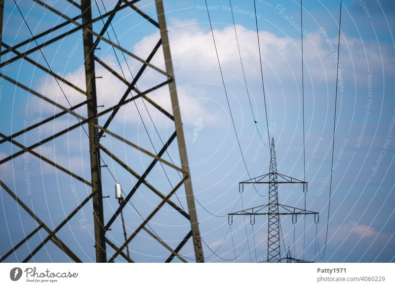 High voltage line and power pylons Electricity pylon High voltage power line Energy industry Transmission lines Technology Sky Exterior shot Industry Cable