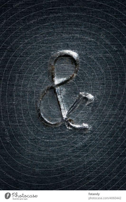 Punched pattern_& kaufmännisches UND et-Zeichen Und Et-Zeichen Aluminium Stahl Blech Detail handwerklich Hintergrund Makro Fläche Material Nahaufnahme Objekt