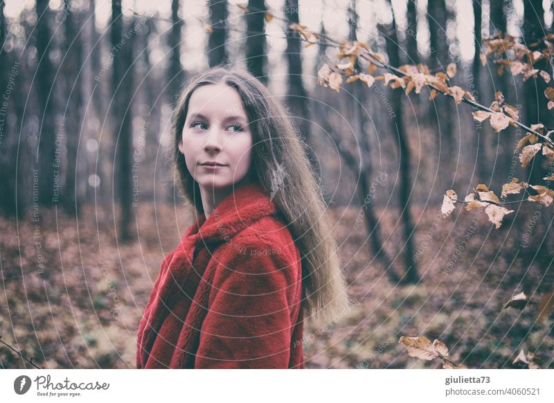 Portrait of long haired teen girl with red fur jacket in autumn forest Youth (Young adults) 13 - 18 years Long-haired Puberty Girl Young woman naturally pretty