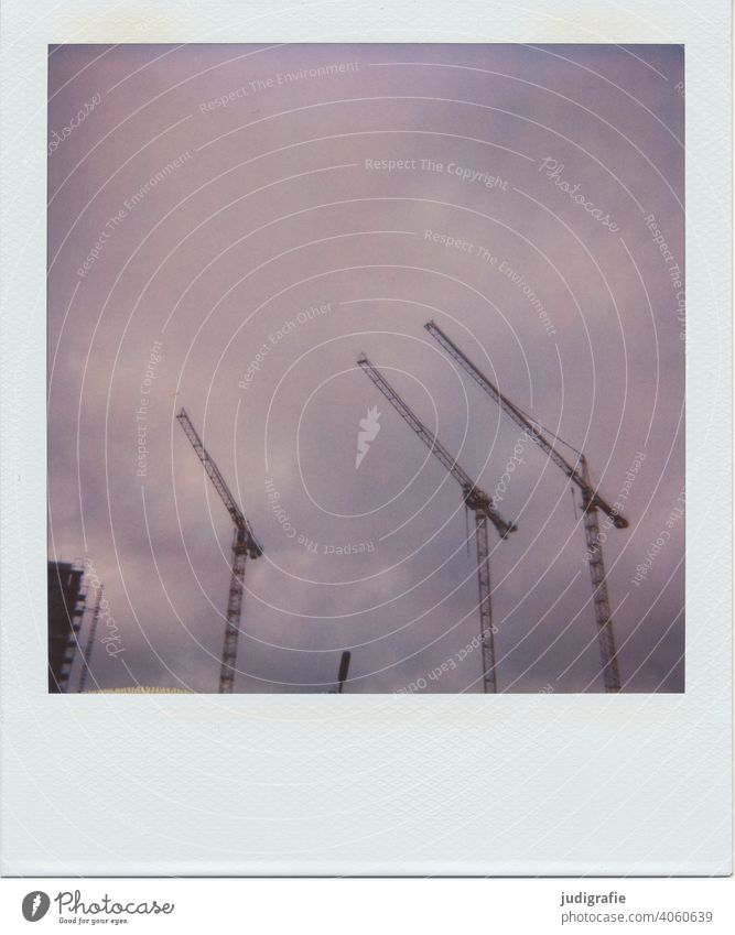 Three cranes on Polaroid Crane Construction site housing Sky Large Tall construction sector Build work Origin Steel technique Construction machinery Deserted