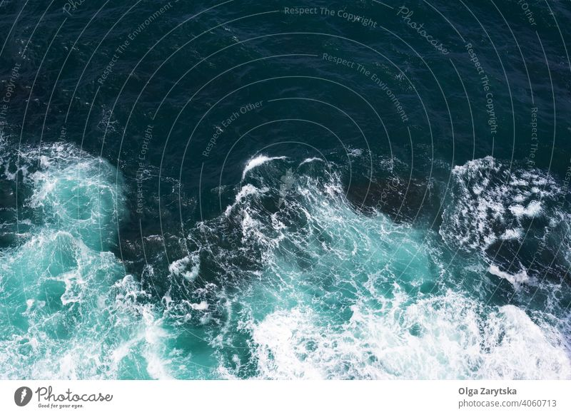Top view on ocean waves. blue nature sea top surf water background summer texture turquoise aqua horizontal marine natural pattern surface wallpaper abstract