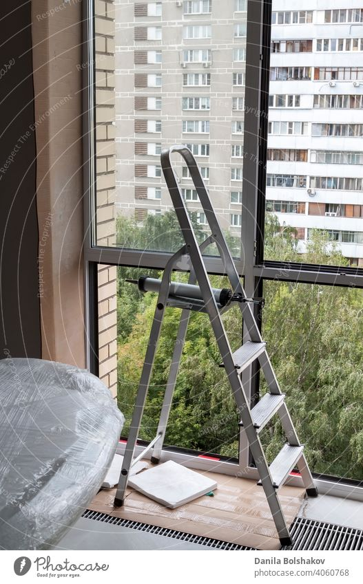 Stepladder near window with glass removed in apartment aluminium building comfortable construction element equipment estate floor frame home house indoor