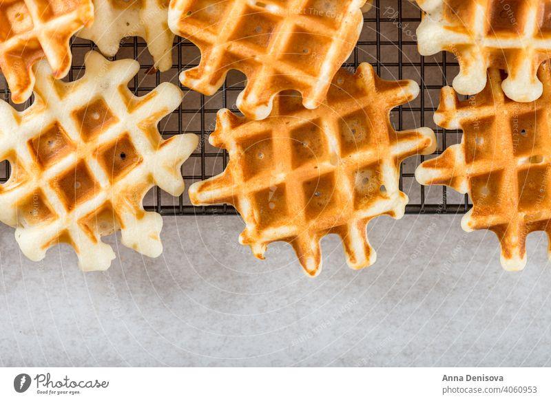 Traditional homemade belgian waffles on light background breakfast dessert blueberry raspberry syrup baked sweet fresh pastry belgium delicious snack bakery
